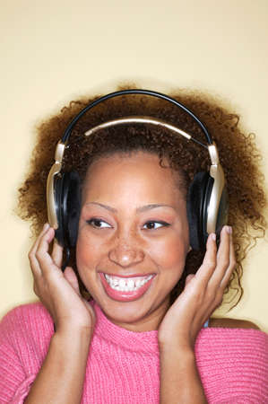 Close-up of a young woman wearing headphones Stock Photo