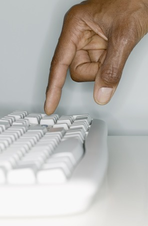 two persons only: Human hand operating a computer keyboard,