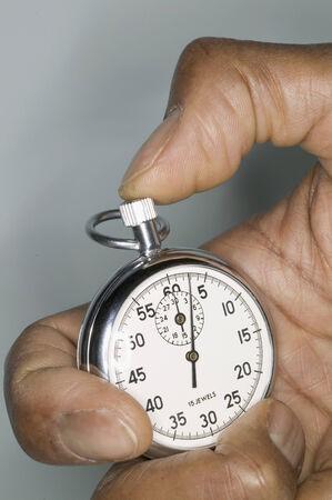 Human hand holding a stopwatch 免版税图像