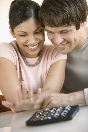 Young couple looking at wedding rings