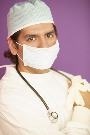 hold ups: Portrait of a male doctor in full scrubs