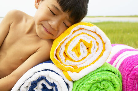 informant: Young boy lying on towels