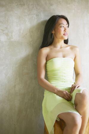 looking ahead: Young woman sitting looking ahead