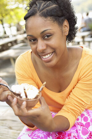 two persons only: Portrait of a young woman eating an ice cream LANG_EVOIMAGES