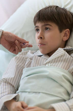 Boy with a thermometer in his mouth