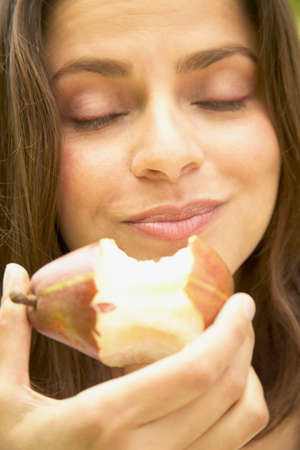 anecdote: Young woman eating an apple