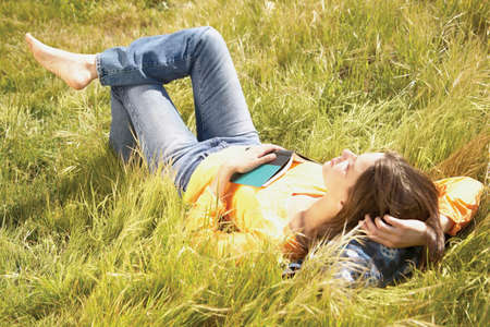 two persons only: High angel view of a young woman lying on grass