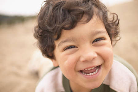 close up: Young boy smiling looking at camera