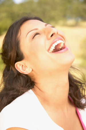 way of behaving: Young woman looking up laughing