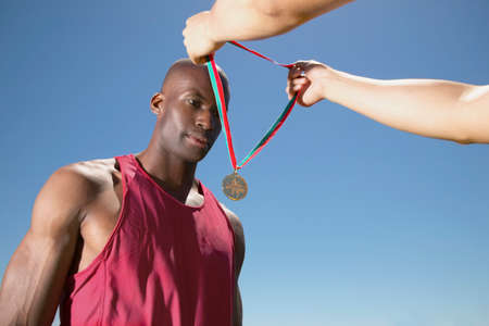 concentrates: Young man receiving a medal