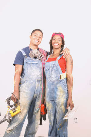 power tools: Portrait of a couple holding power tools