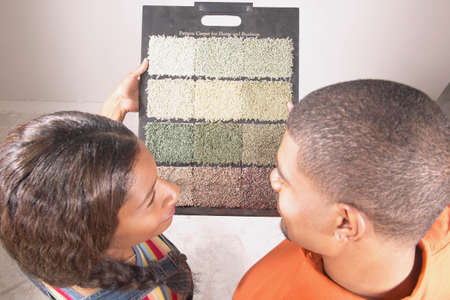 effrontery: Couple looking at carpet samples