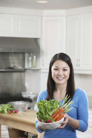 vietnamese ethnicity: Woman In Kitchen with Collender of Vegetables