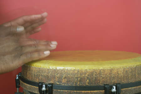 fully unbuttoned: Close-up of a persons hands playing a djembe LANG_EVOIMAGES