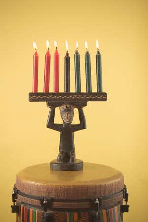 kwanzaa: Kwanzaa candles and a djembe