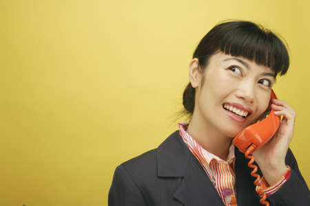 filipino ethnicity: Businesswoman talking on a landline phone