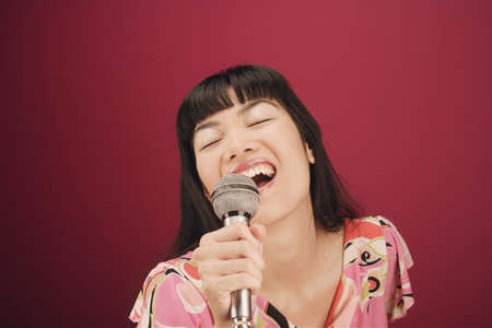 filipino ethnicity: Close-up of a young woman singing