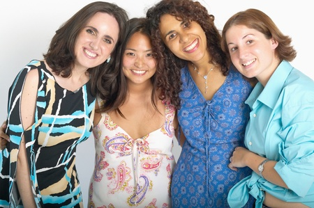 Portrait of a group of young women standing together smiling