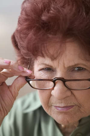 fully unbuttoned: Close-up of a senior woman wearing eyeglasses