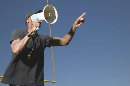 determines: Young man holding a bullhorn LANG_EVOIMAGES