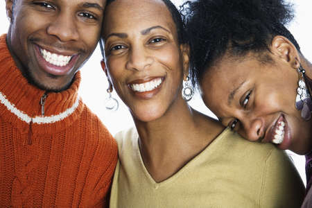 black hair woman: Close-up of a young man smiling with two women