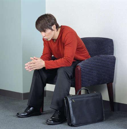 arm chair: Businessman sitting on an arm chair