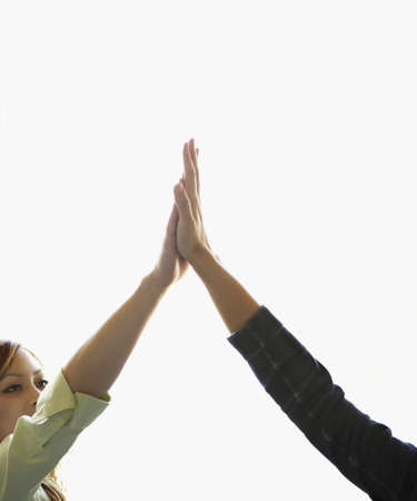 vietnamese ethnicity: Two young women giving high-five