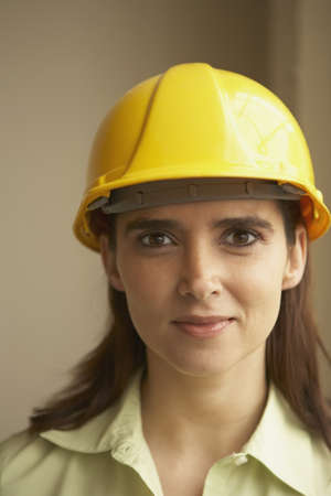 hardhat: Portrait of a businesswoman wearing a hardhat LANG_EVOIMAGES