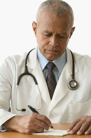 doctor writing: Male doctor writing a prescription