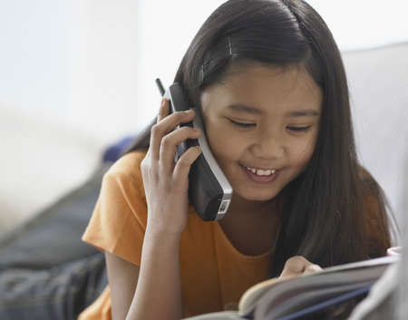 cordless phone: Close-up of a girl talking on a cordless phone