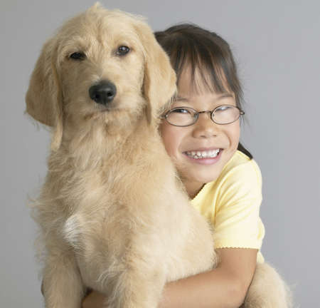 age 40 45 years: Portrait of a girl hugging her dog