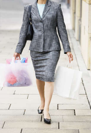 above 30: Woman outdoors carry shopping bags