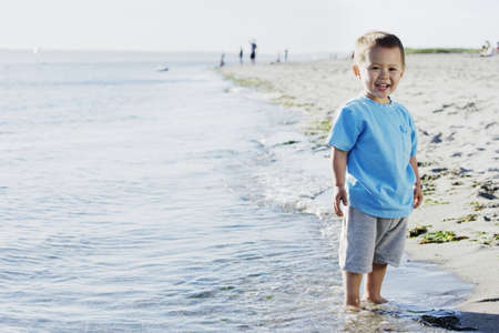 chinese american ethnicity: Boy standing on beach