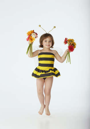 all under 18: Jumping girl in bumblebee costume