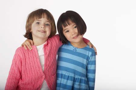 two girls hugging: Two girls hugging LANG_EVOIMAGES