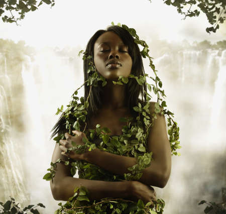 adventuresome: Woman covered in vines outdoors
