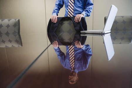 strategizing: Businessman standing next to laptop