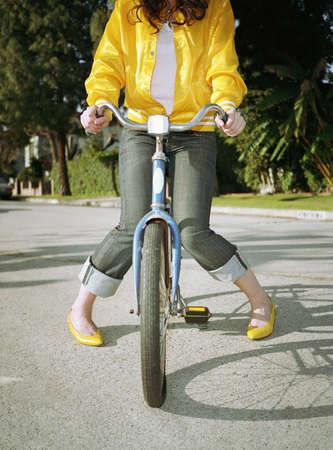 leg warmers: Woman sitting on bicycle