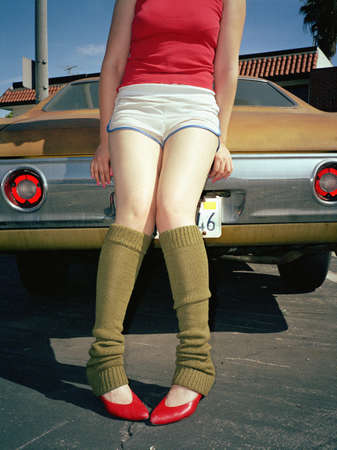 warmers: Young woman in leg warmers and heels
