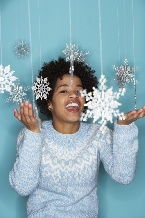 personable: Young woman with snowflake mobile