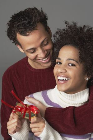 french ethnicity: Young couple with gift