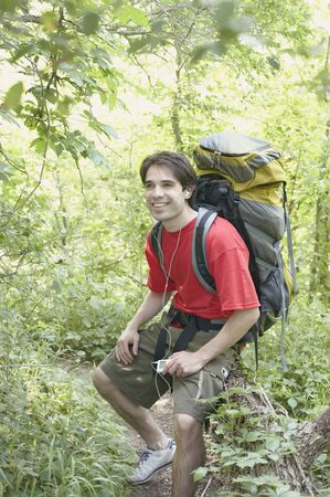 Male hiker listening to music