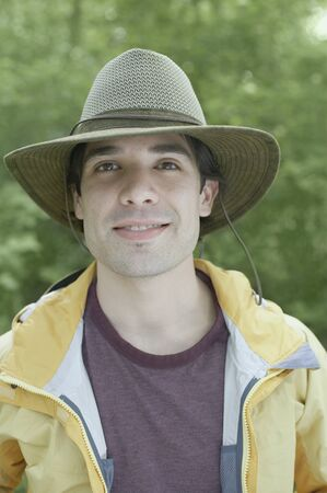 Young man wearing a hat outdoors