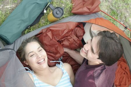 roughing: Overhead view of young couple in a tent LANG_EVOIMAGES