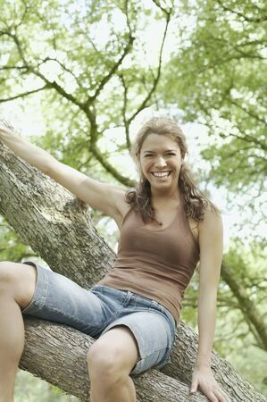 roughing: Looking up at a young woman in a tree