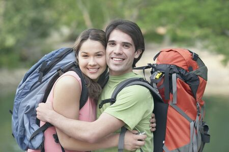 roughing: Young couple embracing outdoors LANG_EVOIMAGES