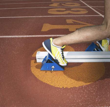 starting blocks: Athletes feet in starting blocks
