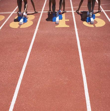 lean machine: Female track athletes at starting line LANG_EVOIMAGES