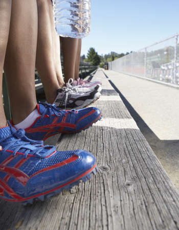 lean machine: Close up of track athletes legs and shoes