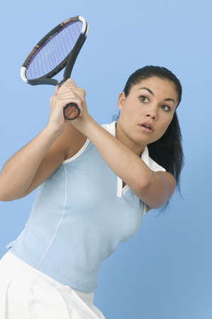 contentedness: Teen girl playing tennis